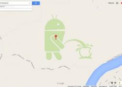 Android-Maskottchen pinkelt auf Apfel